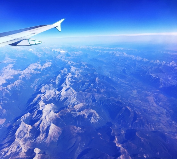 airplane wing over rockies